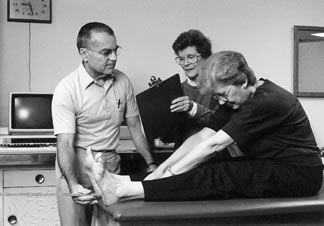 Photo of Howard Peters and Jean Peters measuring flexibility